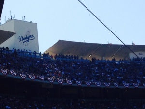 Multiple American Flags fly proudly above Dodgers stadium.