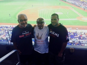 Marlins fan Stephen Paskind and grandson Nick swap baseball stories with Bert