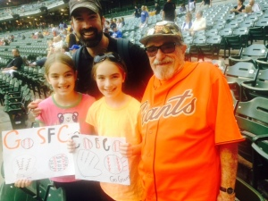 Girls and their dad join Bert in cheering on the Giants