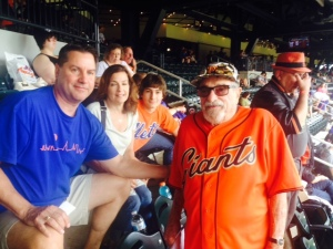 These Mets fans are now thinking about doing an 81 Mets trip when they retire. Jim Scanlon watches the field