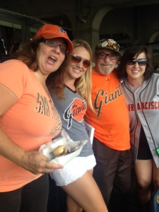 Carley and Sara cheer with Bert and Le Anne. Go Giants!