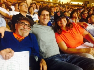 Bert, Aaron, and Le Anne score the game at Dodgers stadium